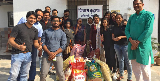 Nuance Pune employees devlier 450kgs of grain to the Kinvara Old Age home